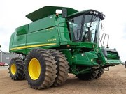 New,  Ex-Demo,  American Combines & Tractors at Wholesale Prices.